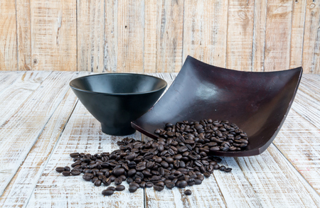 coffeetree: Coffee bean on wood background