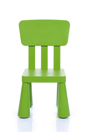 isolated on green: green children plastic chair isolated on white background