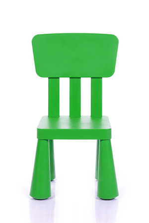baby on chair: green children plastic chair isolated on white background