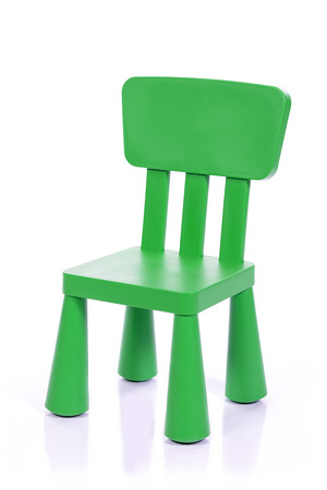 isolated chair: green children plastic chair isolated on white background
