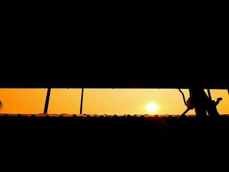 skylights: Sun set in the evening at motorway rest area, Bangkok, Thailand. Stock Photo