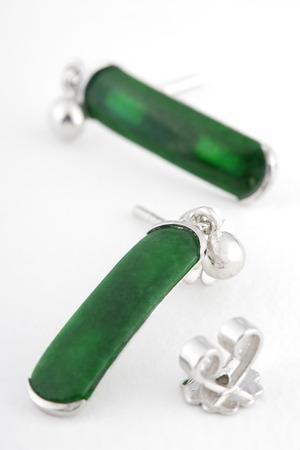 earing: Emerald earing isolated on white background. Macro Stock Photo