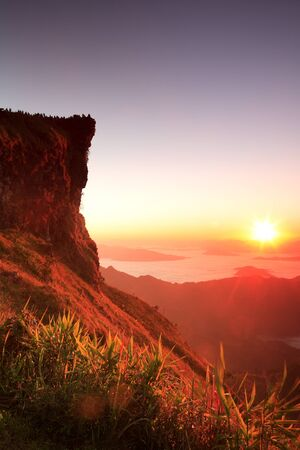 sunrise mountain: Nice sunrise in morning on Phu Chi Fa mountain with twilight, Chiang Rai, Thailand Stock Photo