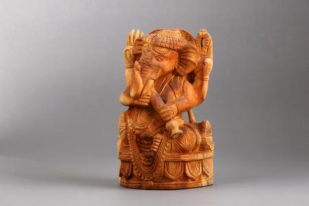 god figure: Ganesha Sandalwood carvings, the elephant-deity riding a mouse of Hinduism.