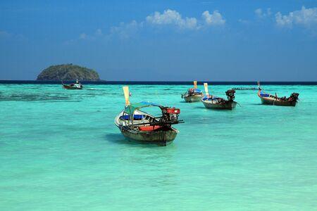 thailand beach: Thai local fishing boats on seaside at Lipe island beach of the Andaman sea, in Satun Province of Thailand.