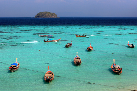 andaman sea: Thai local fishing boats on seaside at Lipe island beach of the Andaman sea, in Satun Province of Thailand.