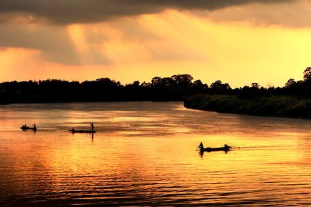 chao phraya: Local fishing boat in dusk with twilight at Chao Phraya River, Thailand. Stock Photo