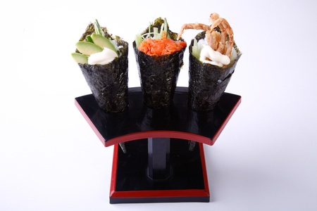 whote: Temaki Sushi, Avocado Spicy Salmon and Soft Shell Crab isolated on whote background.