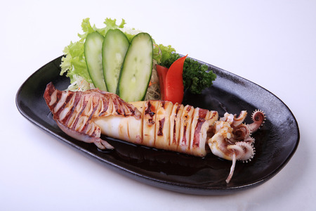 exotically: Ika Teriyaki, roasted squid with teriyaki sauce isolated on white background.