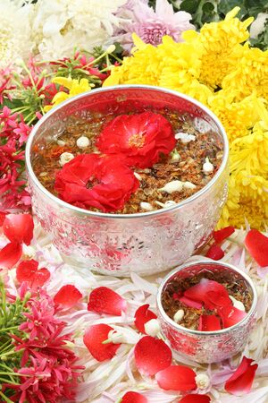 heal new year: Soap Pod water (Acacia concinna) Silver bowl with many flower, this holy water use on Thailand New Year (Songkran Water Festival).