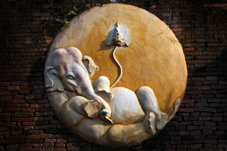 ganesha: Carved cement of Ganesha on brick wall.