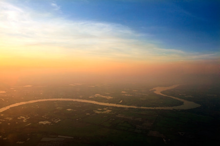 mai: Aerial view of Ping River across paddy field, Chiang Mai, Thailand.