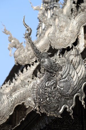 chinese phoenix: Traditional Chinese Phoenix on Silver roof of Buddhism temple, Chiang Mai, Thailand.