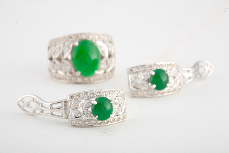 earing: Jade and diamond set, earing and ring isolated on white background.