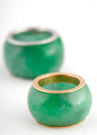platinum: Jade pendant with gold edges and platinum edges isolated on white background.