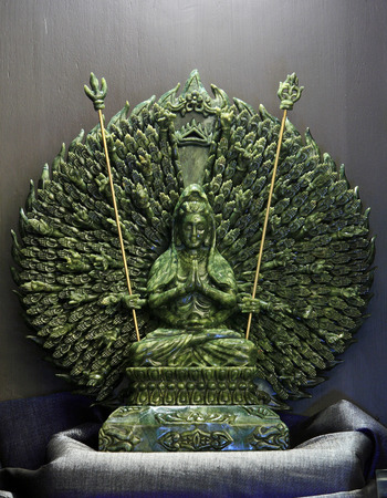 goddess of mercy: Jade sculpture of Guanyin thousand hands, Goddess of Mercy in China.