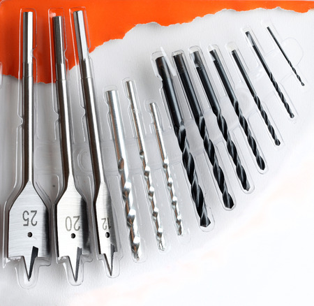 woodruff: Group of Taper Drills on white and orange. Stock Photo