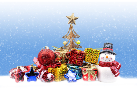 box tree: Christmas background with ornaments, gift box, tree and snowman