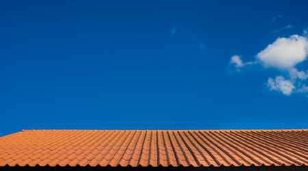 orange rooftop over blue sky as a background
