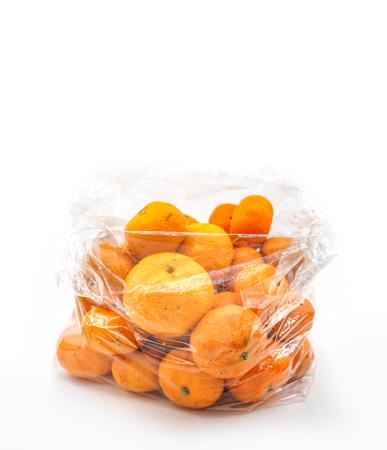 Mandarins in plastic bag isolated on white