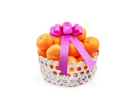 basket of orange as a lucky gift with pink ribbon - chinese new year