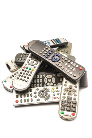 remotes: Stack of  remote wireless control electronics device on white background