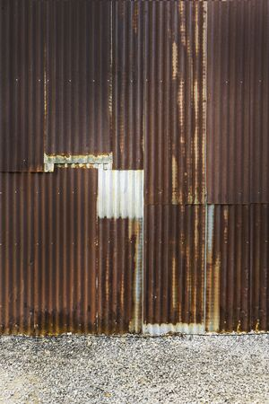 old rusty zinc plate fence wall background Stock Photo