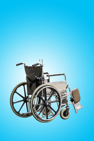 Wheel Chair on blue sky background Stock Photo