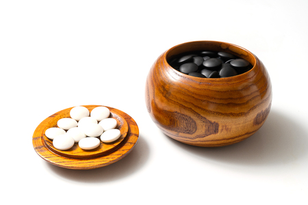 Chinese, Japan, Korean board game GO with black and white stone. Go or wei-Chi - WeiQi traditional asian board game