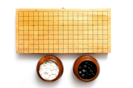 Chinese, Japan, Korean board game GO with black and white stone. Go or wei-Chi - WeiQi traditional asian board game Standard-Bild - 103984796