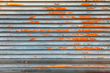 old rusty metal sheet door with scratch texture panel background