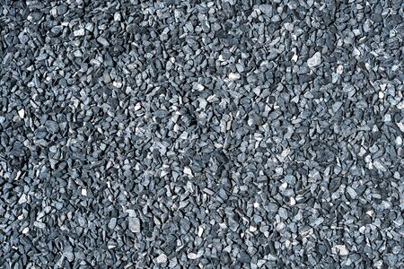 crushed grey stone on ground texture background Фото со стока