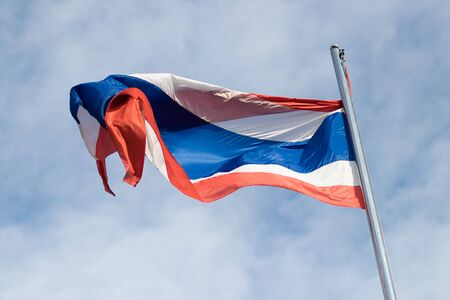 winding on Thailand flag on pole