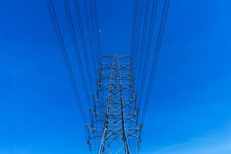 high voltage pole - electric power tower on blue sky background