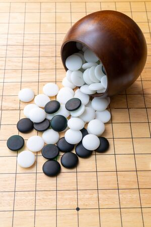 board game iGO  - strategy board game with black and white stone Фото со стока