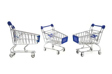 empty metal shopping trolley isolated on white