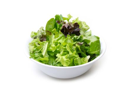 salad mixed with rucola, frisee, radicchio and lambs lettuce  on white background Imagens