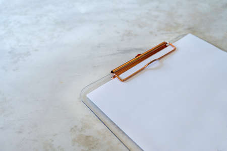 transparent Clipboard with blank white paper  isolated on mable background with text space
