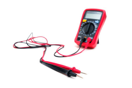 Red digital multimeter with probes on white background - Multimeter is an electronic measuring instrument for voltage, amper, resistance Banque d'images