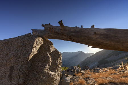 pct: Canyon Sunset - The sun sets behind a granite canyon in the Sierra Nevada on the pacific crest trail. Stock Photo