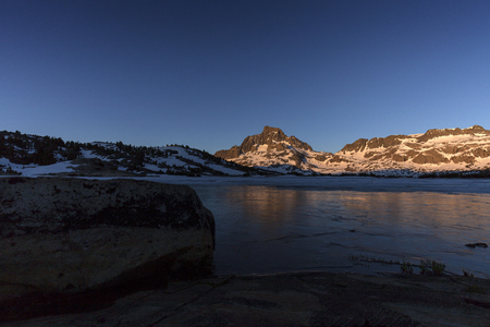sierra: Frozen Sierra Sunrise - Sunrise on granite Banner Peak in the Sierra Nevada mountains on the pacific crest trail. Stock Photo