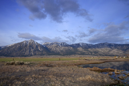 High Sierras - Early morning clouds rolling over snowy sierra mountains. Stock Photo