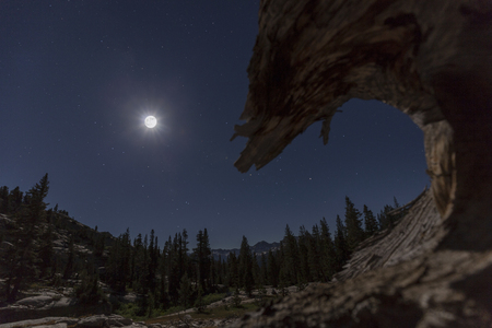 Mountain Moon - Bright moving moon over Sierra Nevada mountain landscape on the pacific crest trail.