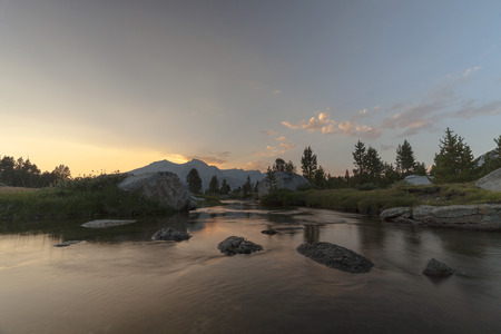High Meadow Sierras - The red sun sets behind granite walls of the Sierra Nevada on the pacific crest trail.