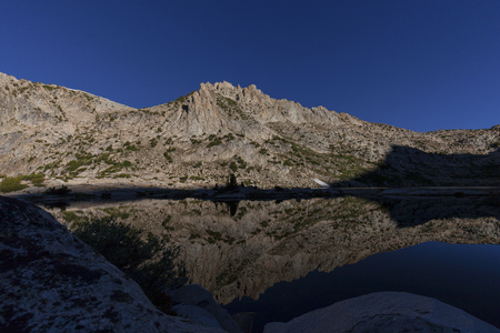 pct: Silver Pass Lake - Sunrise on granite Sierra Nevada peaks on the pacific crest trail.