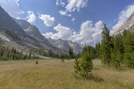 Granite Giants - Large granite monolith mountains rise from a high Sierra mountain valley. Stock Photo