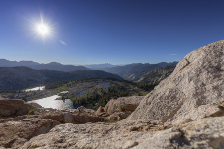 pct: Hot Sun Over Sierra Nevada Mountains - The summer sun burns bright over the Sierra Nevada mountains in California. Stock Photo