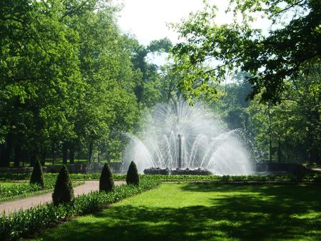 Petergof, Saint peterburg, Russia - JUNE 12, 2013: High round lush white fountain in the park of Petergof. Editorial