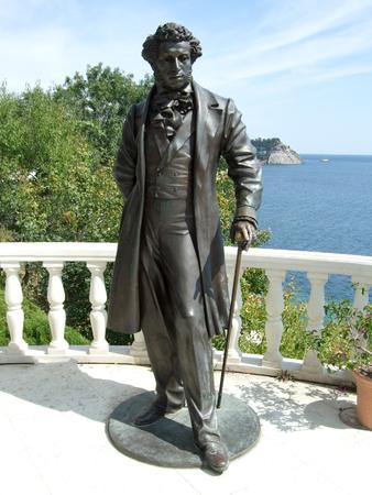Black Pushkin monument in Aivazovsky park. Partenit park. Suuny day. Crimea. Russia