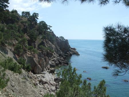 Coastline of sea with hills. Black sea. Crimea Shining Stock Photo